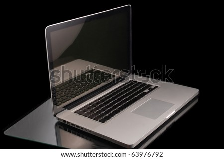 Aluminium laptop with desktop on black background
