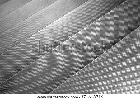 Aluminium metal texture steps for grunge style backgrounds or backdrops. Natural light effect on the shiny reflective surface. Plenty of copy space for designs or text. - stock photo
