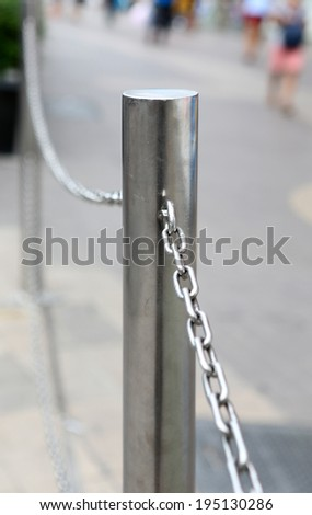 aluminium stanchion with chain - stock photo