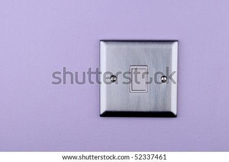 Aluminium switch on on the violet wall - stock photo