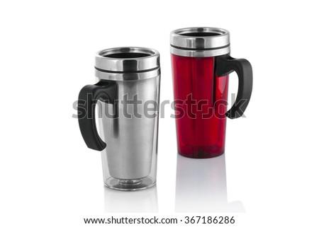 Aluminum and red mug isolated on white - stock photo