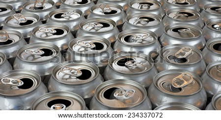 aluminum can recycling close up view tops of empty cans in symmetrical rows, landscape horizontal view - stock photo