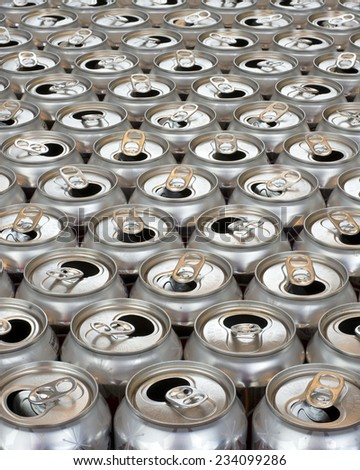 aluminum can recycling close up view tops of empty cans vertical view - stock photo