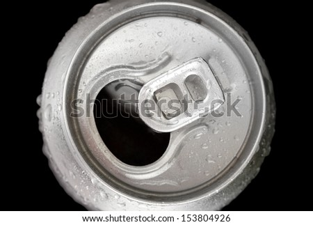 Aluminum can with water drops isolated on black - stock photo