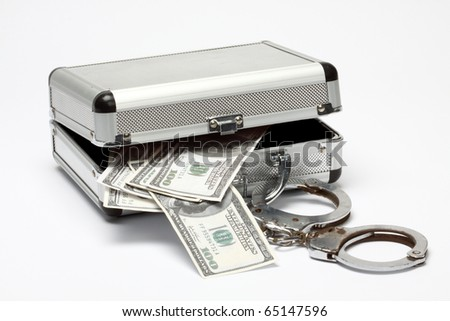 aluminum case with money and handcuffs over white background - stock photo