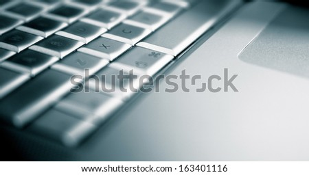 Aluminum laptop. Detail. Modern technology concept