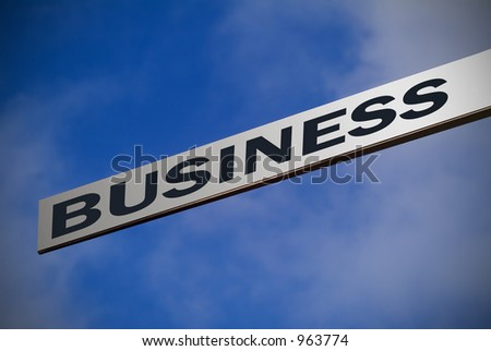 Aluminum or stainless steel finger sign against blue sky ready pointing to BUSINESS