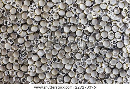 Aluminum plastic background, which is used as a bottle opener. - stock photo