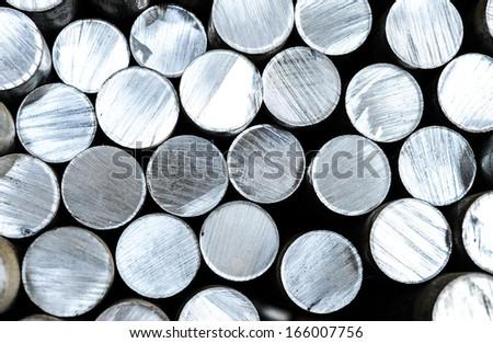 Aluminum rods in smelting plant - stock photo