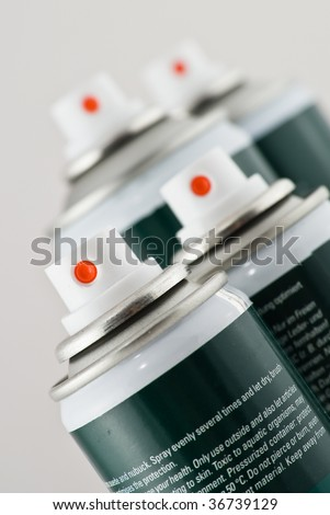 Aluminum spray cans with nozzles - stock photo