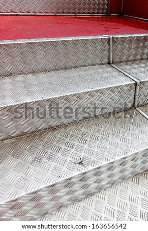 Aluminum steps with non-slip pattern.  - stock photo