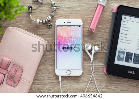 Alushta, Russia - November 5, 2015: iPhone6S Rose Gold with app Apple Music on the screen. iPhone 6S Rose Gold was created and developed by the Apple inc. - stock photo