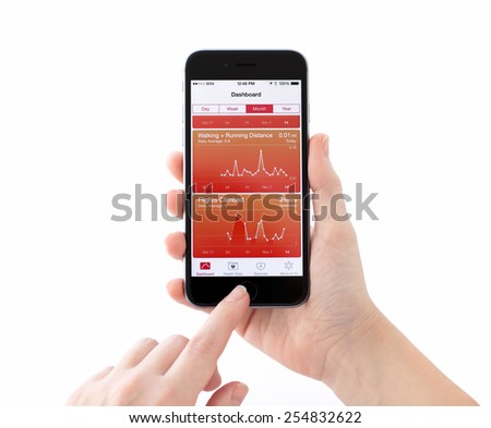 Alushta, Russia - November 14, 2014: New iPhone 6 Space Gray with Apple service Health on the screen in a woman hand. iPhone 6 was created and developed by the Apple inc. - stock photo