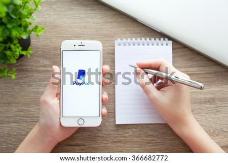 Alushta, Russia - November 5, 2015: Woman holding a iPhone 6S Rose Gold with service PayPal on the screen. iPhone 6S was created and developed by the Apple inc - stock photo