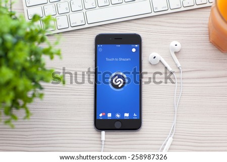 Alushta, Russia - October 25, 2014: iPhone 6 Space Gray with music service Shazam on the screen. iPhone 6 was created and developed by the Apple inc. - stock photo