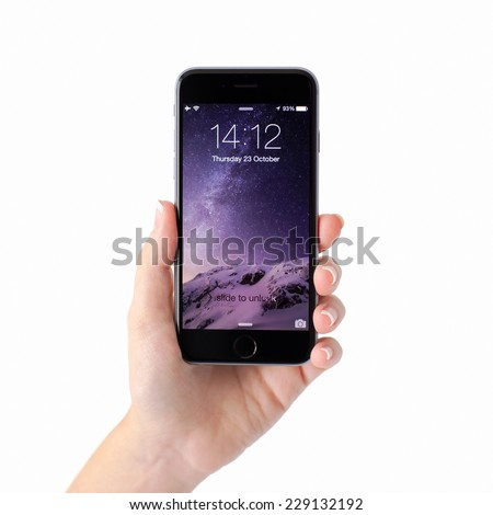 Alushta, Russia - October 23, 2014: Woman hand holding iPhone 6 Space Gray with unlock on the screen. iPhone 6 was created and developed by the Apple inc. - stock photo