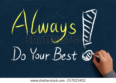 Always do your best on blue chalkboard with the hand of businessman. - stock photo