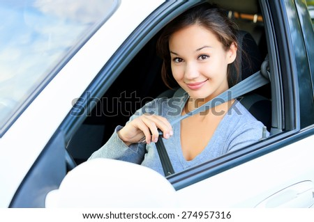 Always fasten your seatbelt. Girl in a car - stock photo