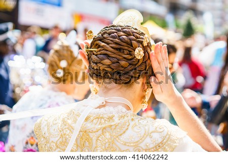 ALZIRA,SPAIN - MARCH 17: Several unidentified women walk in the offering of Fallas, one of the biggest parties in Spain on March 17,2016 in Alzira,Valencia,Spain. - stock photo