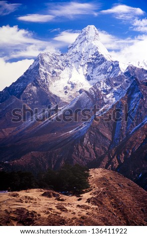 Ama Dablam in the Everest region of the Nepal Himalaya mountain range - stock photo
