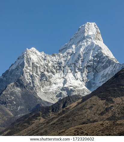 Ama Dablam (6812 m) in morning (view from Tengboche monastery) - Everest region, Nepal, Himalayas - stock photo