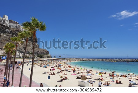 AMADORES BEACH, SPAIN - JULY 23; View at the View overAmadores beach, Gran Canaria, Spain. Popular travel location. Photo taken on July 23, 2014 in Gran Canaria. - stock photo