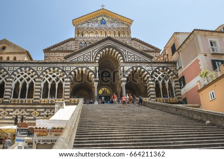 AMALFI, ITALY - MAY 23, 2017: bell tower and central facade of Amalfi Cathedral, dedicated to the Apostle Saint Andrew, Roman Catholic cathedral in the Piazza del Duomo, Amalfi, Italy