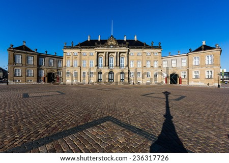 Amalienborg is the residence of the Danish Royal Family. The palace is octagonal with a statue of King Frederik V in centre. - stock photo