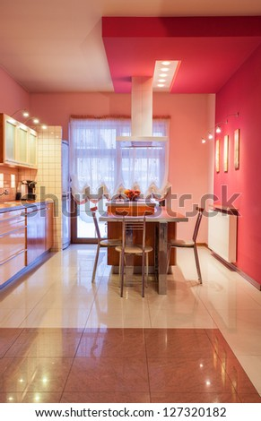 Amaranth house - Kitchen in sweet pink color - stock photo