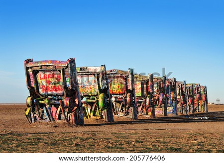 AMARILLO, TEXAS, USA - DEC. 2013: Cadillac Ranch is a public art installation and sculpture in Texas, U.S. created in 1974 by Chip Lord, Hudson Marquez and Doug Michels, of the art group Ant Farm. - stock photo
