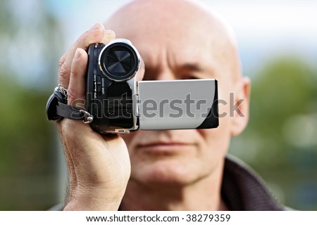 amateur cameraman with a small digital camcorder