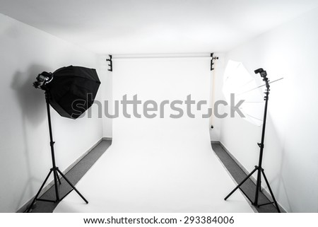 Amateur home made photo studio in the basement. Inexpensive Self made background in the photo studio. - stock photo