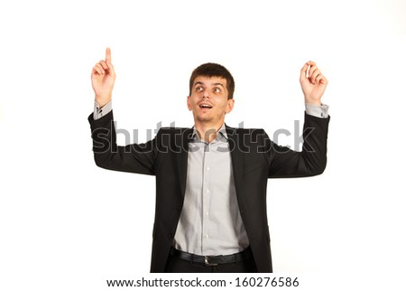 Amazed business man raising hands and pointing up isolated on white background