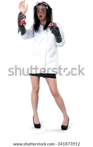 Amazed Caucasian young woman with long dark brown hair in uniform holding brain - Isolated - stock photo