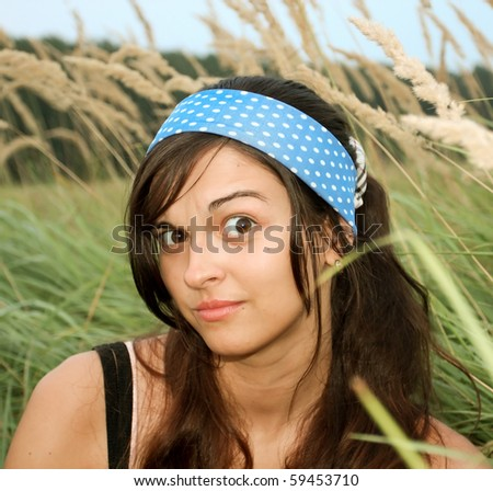 amazed female face with retro blue bandage white polka-dot