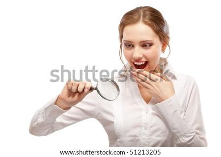 Amazed girl looks through magnifier, isolated on white background. - stock photo
