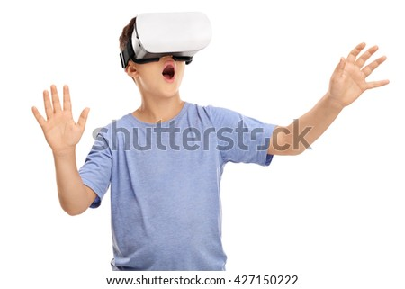 Amazed little boy looking in a VR goggles and gesturing with his hands isolated on white background - stock photo