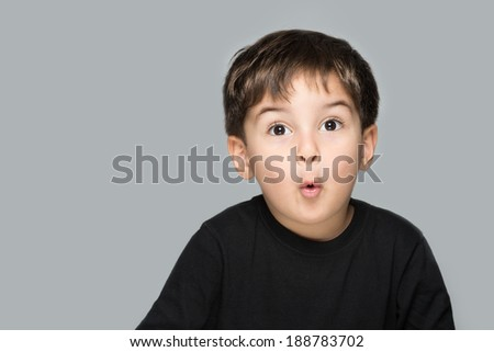 Amazed little kid very excited - stock photo