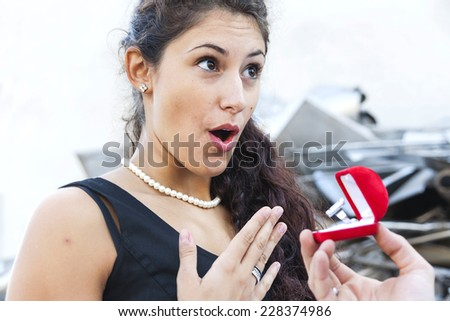 amazed teenager receives a ring as a gift - stock photo