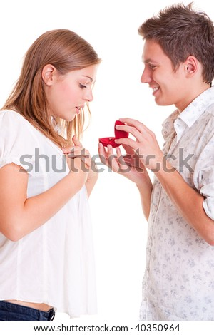 amazed woman looking at present and happy man looking at her