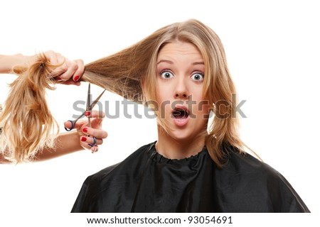 amazed woman with long hair and scissors. isolated on white background - stock photo