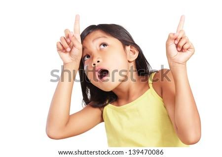 Amazed young girl pointing upward. - stock photo