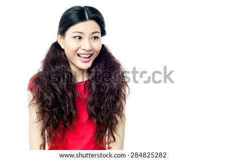 Amazed young woman looking at copy space