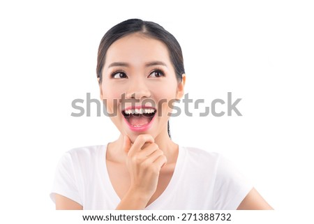 amazement - woman excited looking to the side. Surprised happy young woman looking sideways in excitement. Mixed race Chinese Asian / white Caucasian female model on green background - stock photo