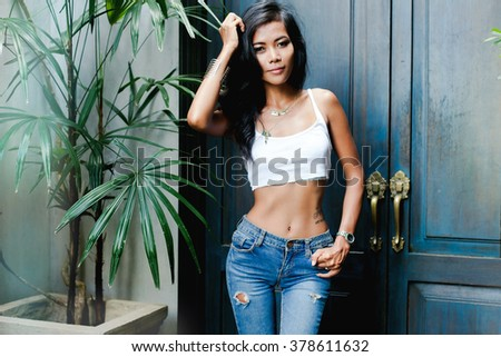 amazement - woman excited looking to the side. Surprised happy young woman looking sideways in excitement.Mixed race Chinese Asian/white Caucasian female model on street style,casual girl,slim body - stock photo