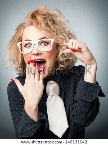 Amazement woman have a idea, isolated on gray - stock photo