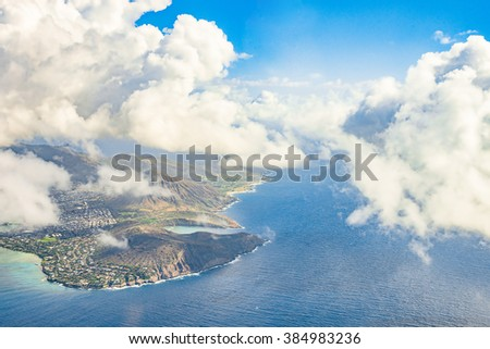 Amazing aerial island view among the clouds on the horizon in the middle of the Pacific ocean. Hawaii.  - stock photo