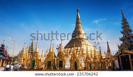 Amazing architecture of Shwedagon or Great Dagon Pagoda. Most sacred Buddhist place with relics of four past Buddhas. Yangon, Myanmar (Burma) travel landscapes and destinations. Ten images panorama - stock photo