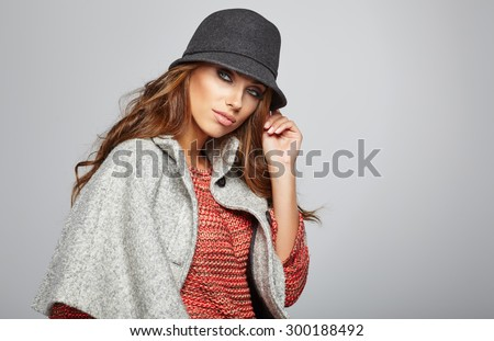 Amazing beautiful  brunette woman in autumn color. Studio shoot - stock photo