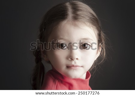 Amazing beautiful girl with pigtails and big eyes